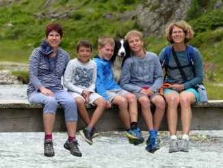 Hikers on a bridge on the Wilde Wasser Weg in Austria's Stubai Valley.