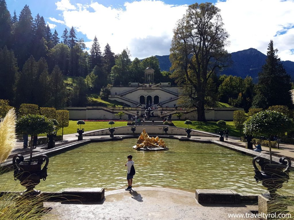 Linderhof Palace fountain and lime tree in garden.